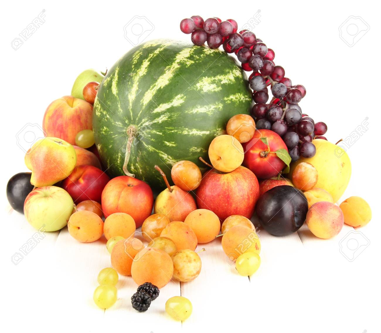 Still life of fruit on wooden table isolated on white Stock Photo - 15600941