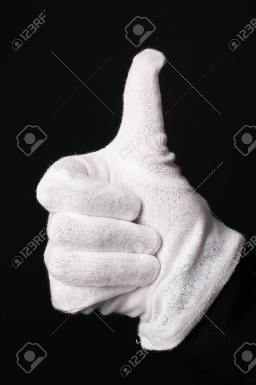 Hand in white glove making sign isolated on black Stock Photo - 15592886