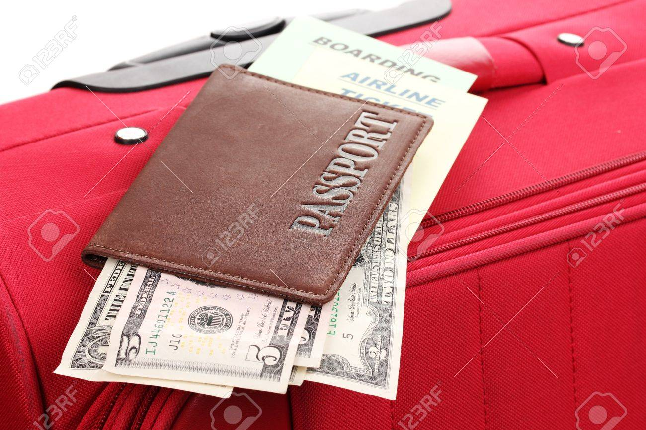 Passport and ticket on suitecase close-up Stock Photo - 15627796