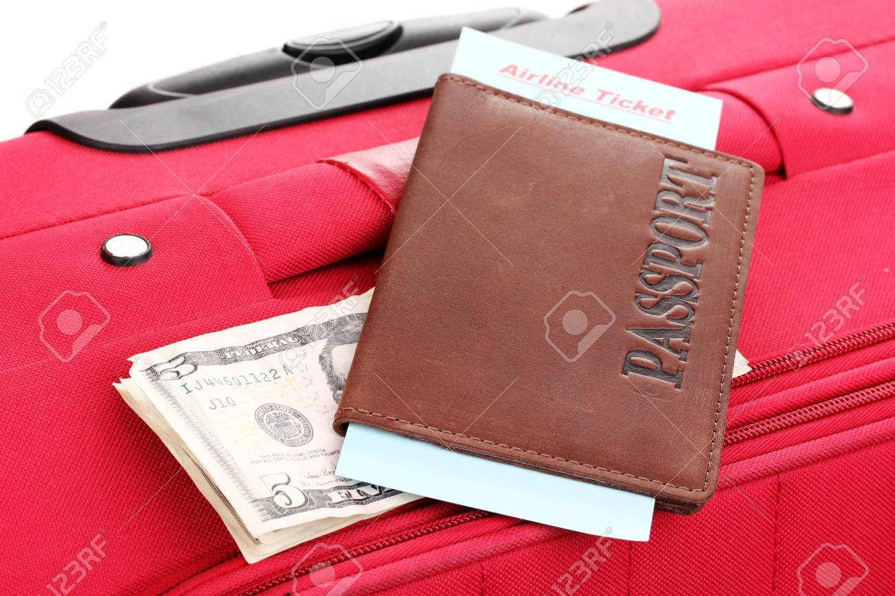 Passport and ticket on suitecase close-up Stock Photo - 15665512