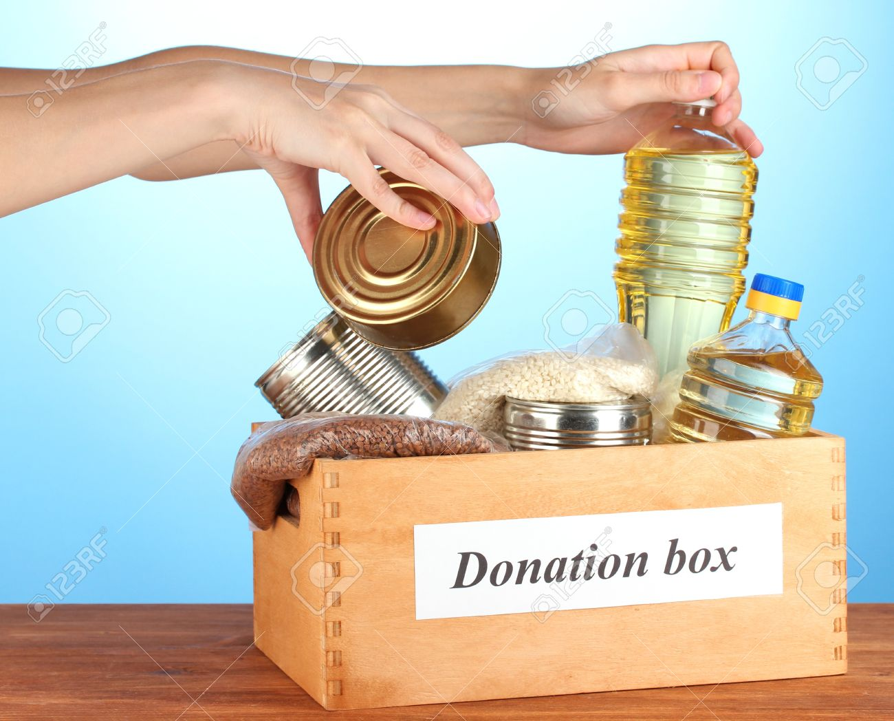 Donation box with food on blue background close-up Stock Photo - 15738751
