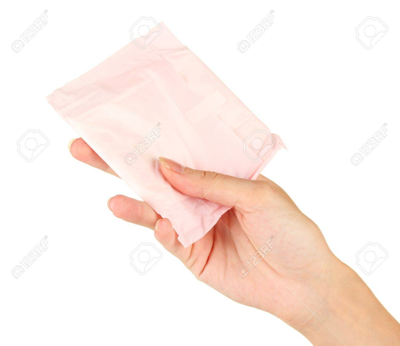 woman's hand holding a panty liner in individual packing on white background close-up Stock Photo - 15736459