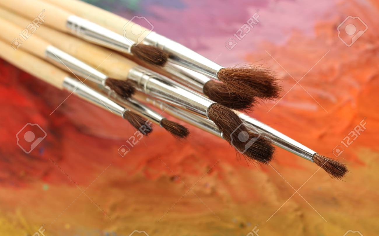 acrylic paint and brushes on wooden palette Stock Photo - 15742937