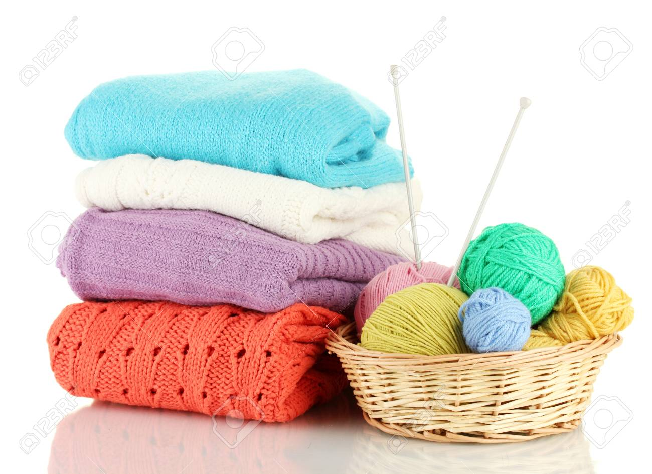 Sweaters and balls of wool isolated on white Stock Photo - 15773056