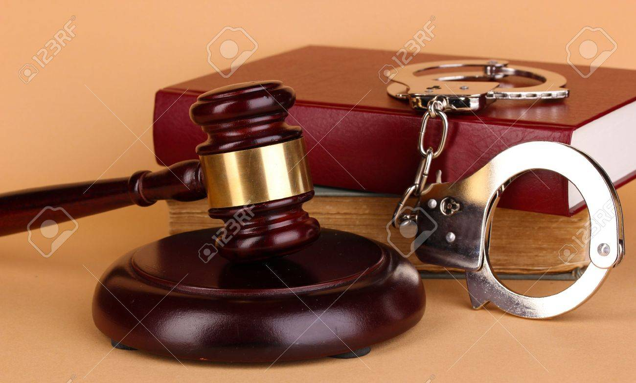 Gavel, handcuffs and book on law on beige background - 15773165