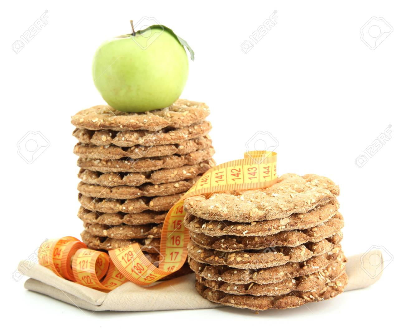 tasty crispbread, apple and measuring tape, isolated on white Stock Photo - 15851903