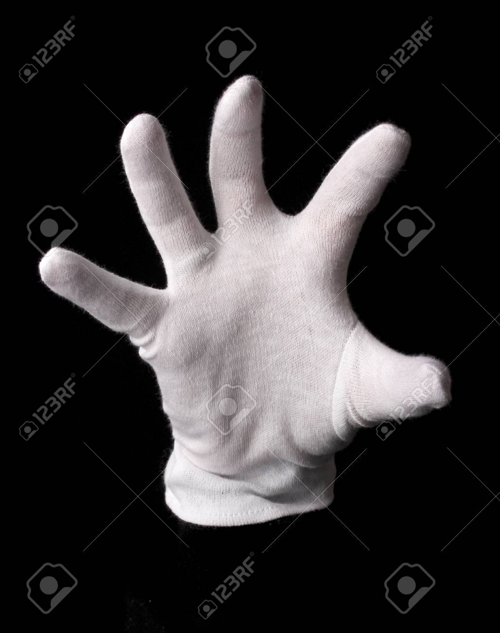 Hand in white glove making sign isolated on black Stock Photo - 15851819