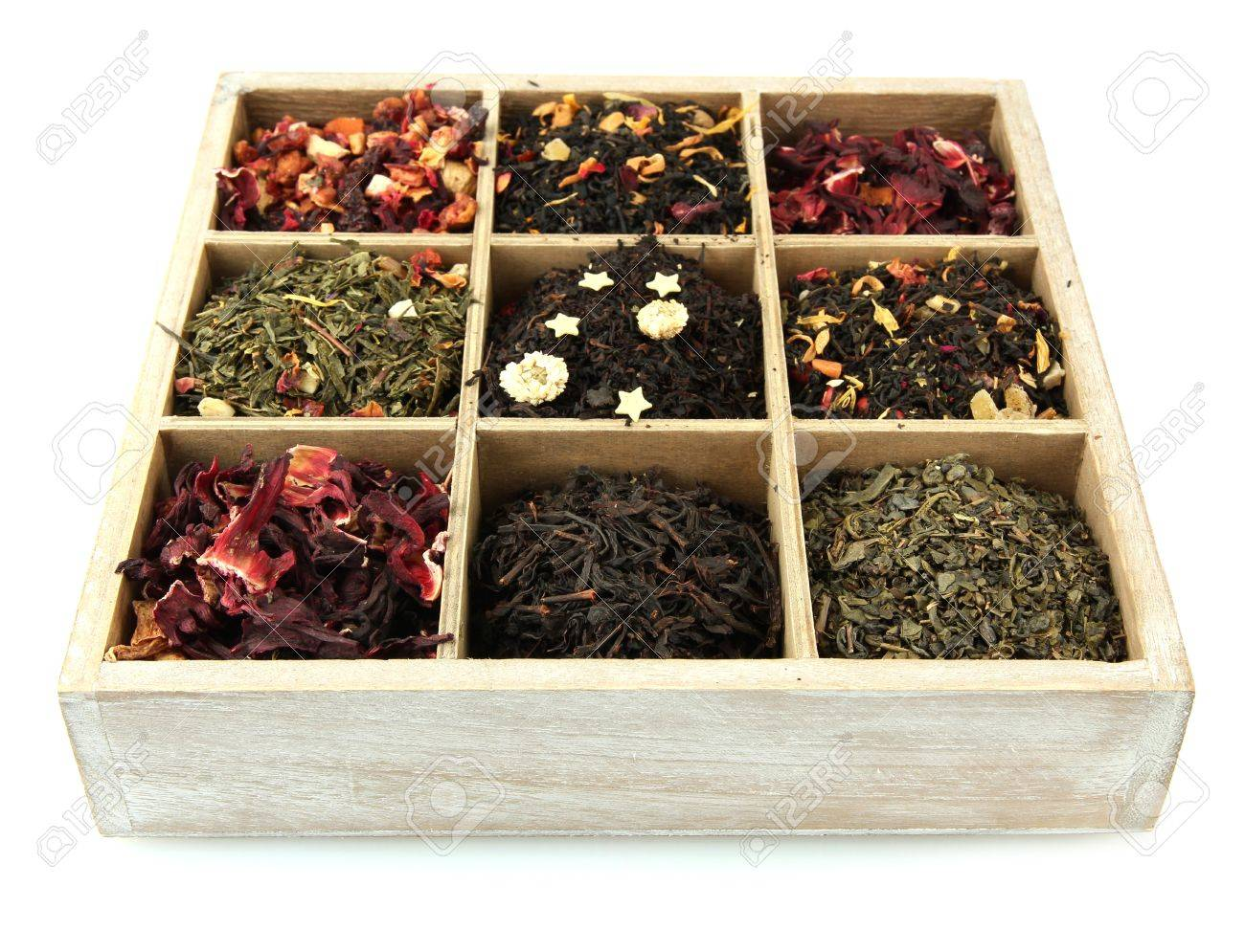 Assortment Of Dry Tea In Wooden Box Isolated On White