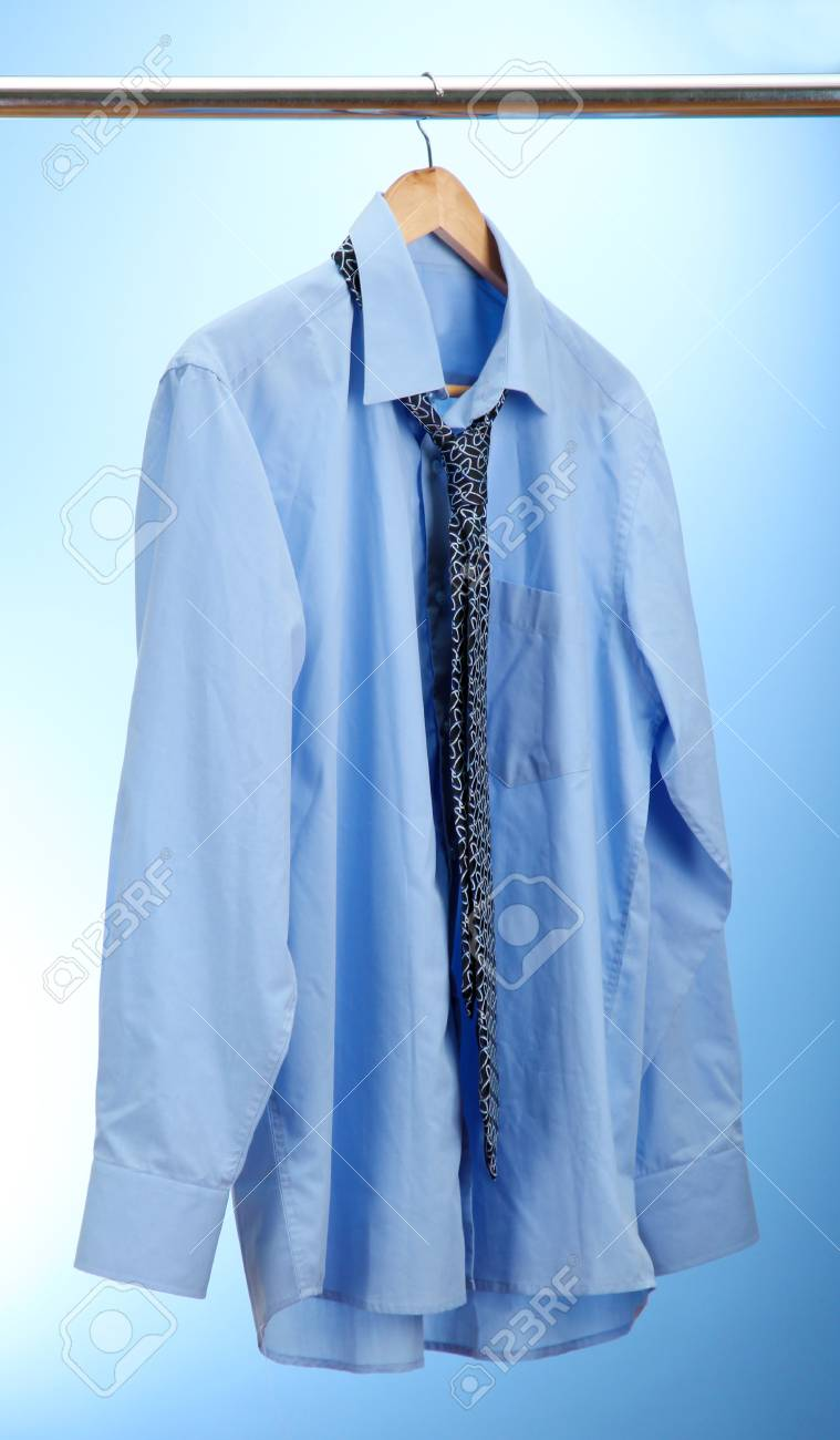 shirt with tie on wooden hanger on blue background Stock Photo - 16107466