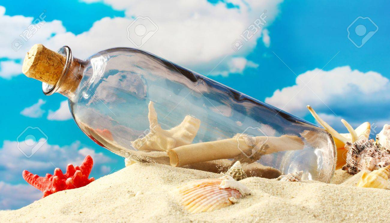 Glass bottle with note inside on sand, on blue sky background Stock Photo - 16132277
