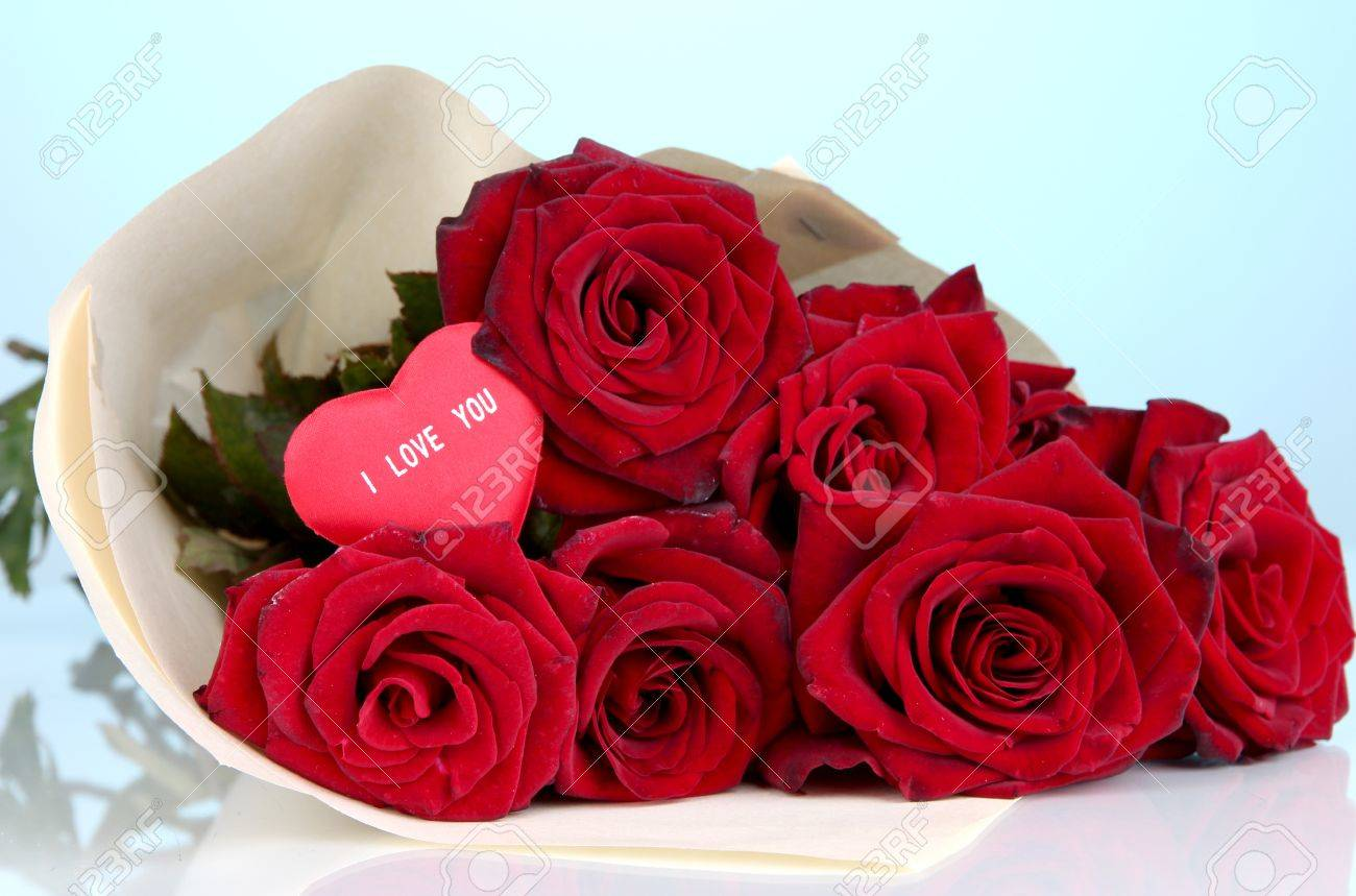 Beautiful bouquet of red roses with valentine on blue background beautiful bouquet of red roses with valentine on blue background stock photo 16132160 izmirmasajfo