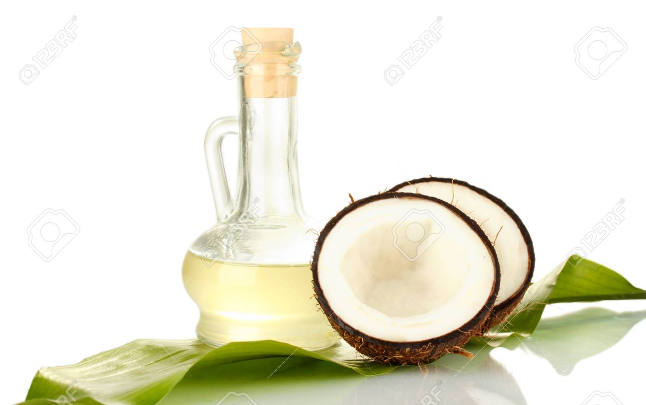 decanter with coconut oil and coconuts isolated on white Stock Photo - 16315335
