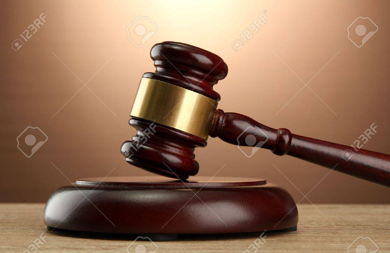 wooden gavel on wooden table, on brown background Stock Photo - 16314249