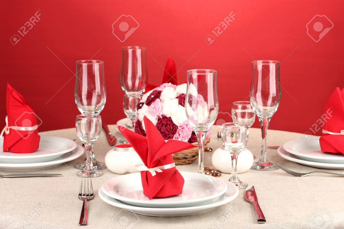 Table Setting Background table setting in red tones on color background stock photo