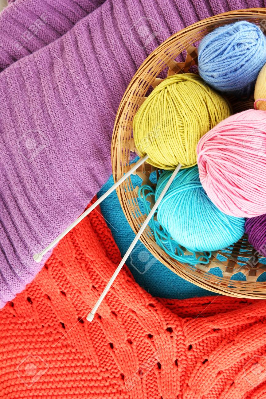 colorful wool sweaters and balls of wool close-up Stock Photo - 16501356