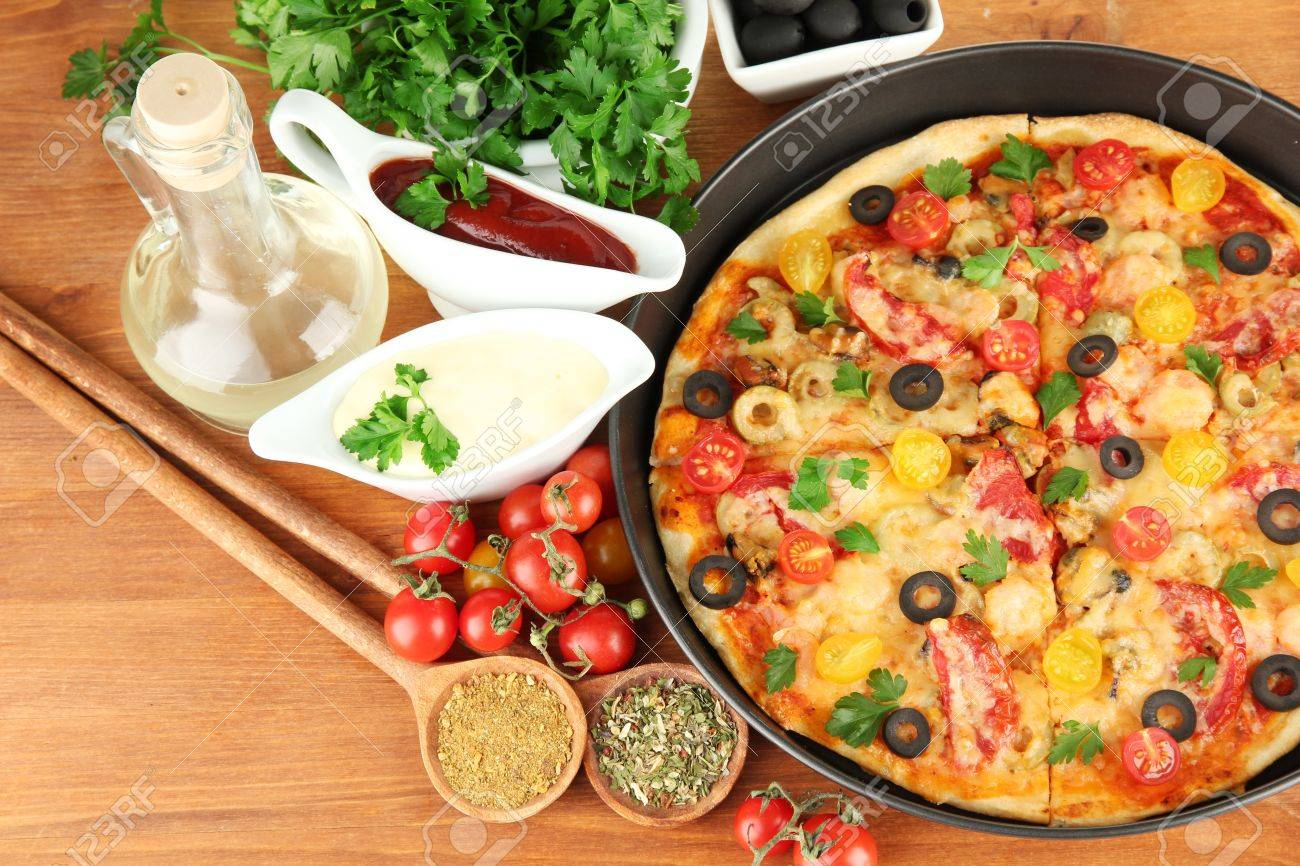 colorful composition of delicious pizza, vegetables and spices on wooden background close-up Stock Photo - 16501311
