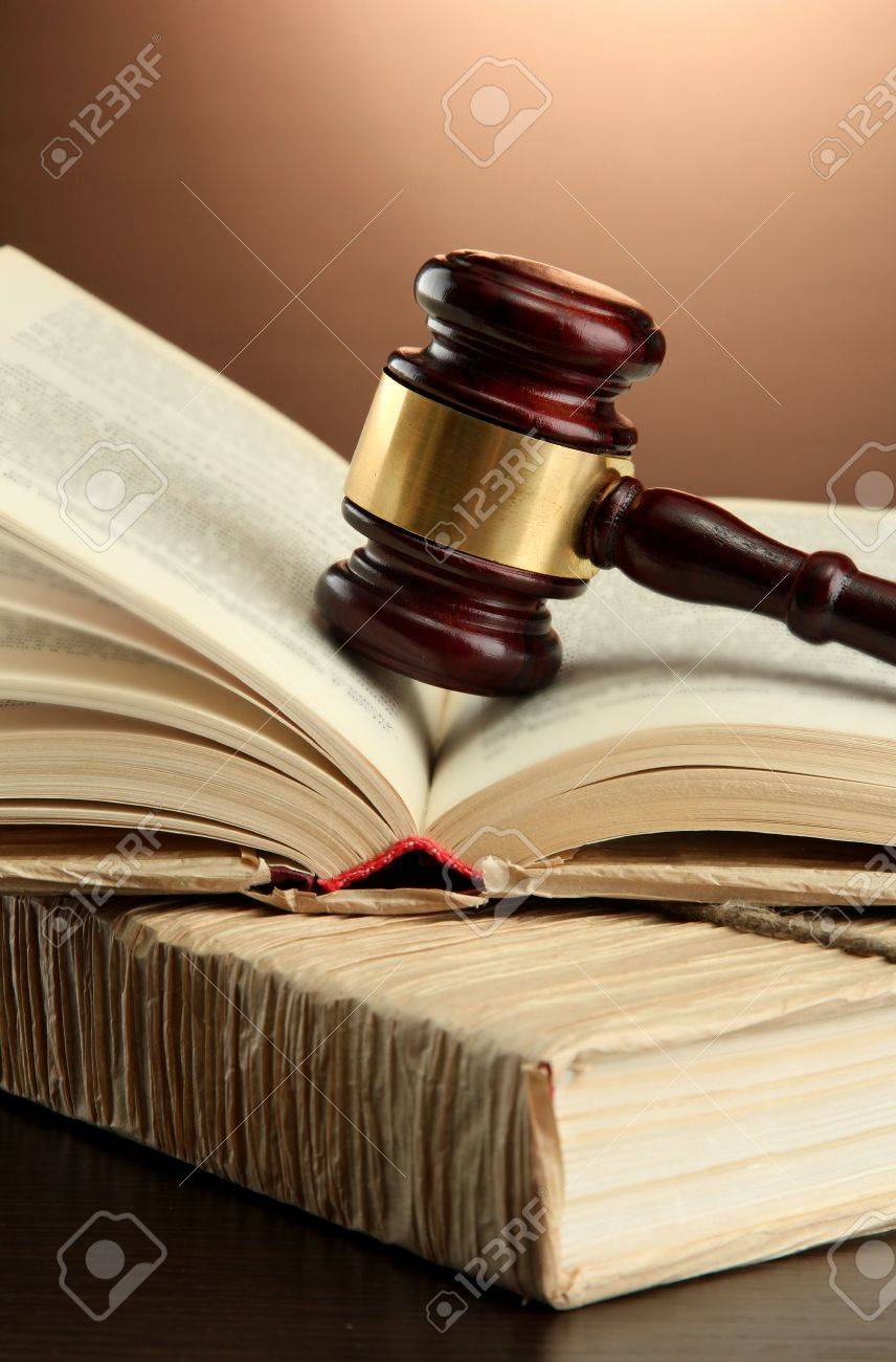 wooden gavel on books, on brown background Stock Photo - 16500605