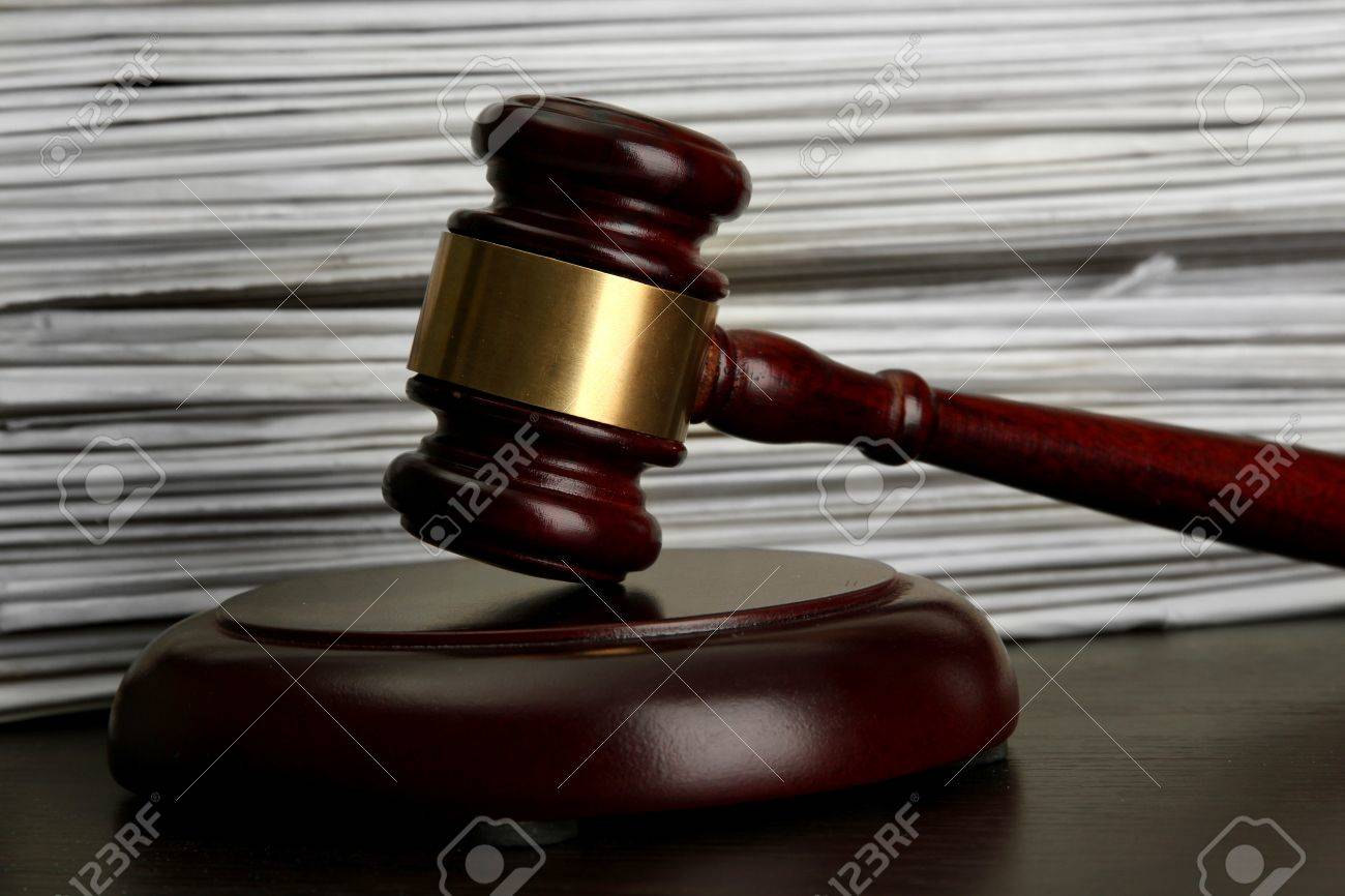 gavel on old papers background Stock Photo - 16561344