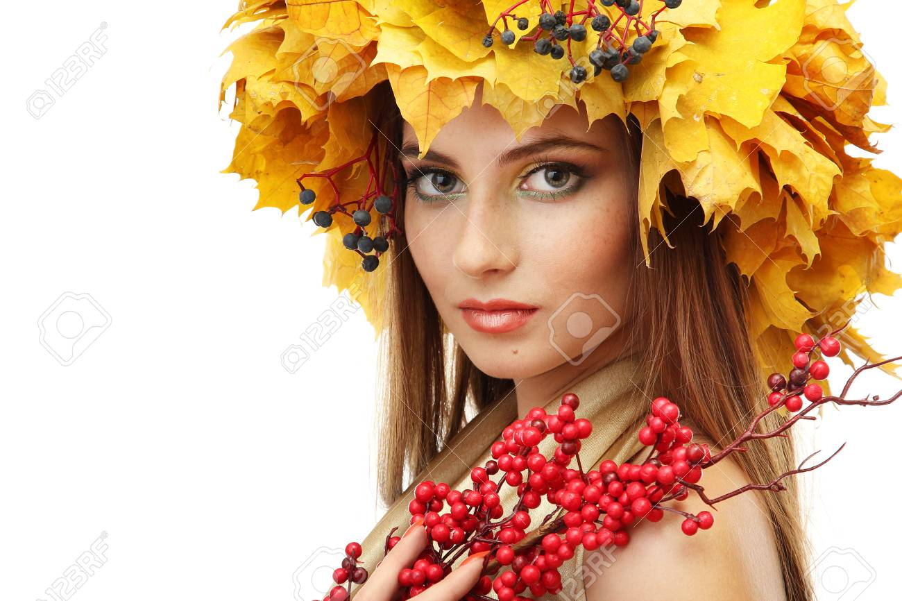 beautiful young woman with yellow autumn wreath and red berries, isolated on white Stock Photo - 17051679