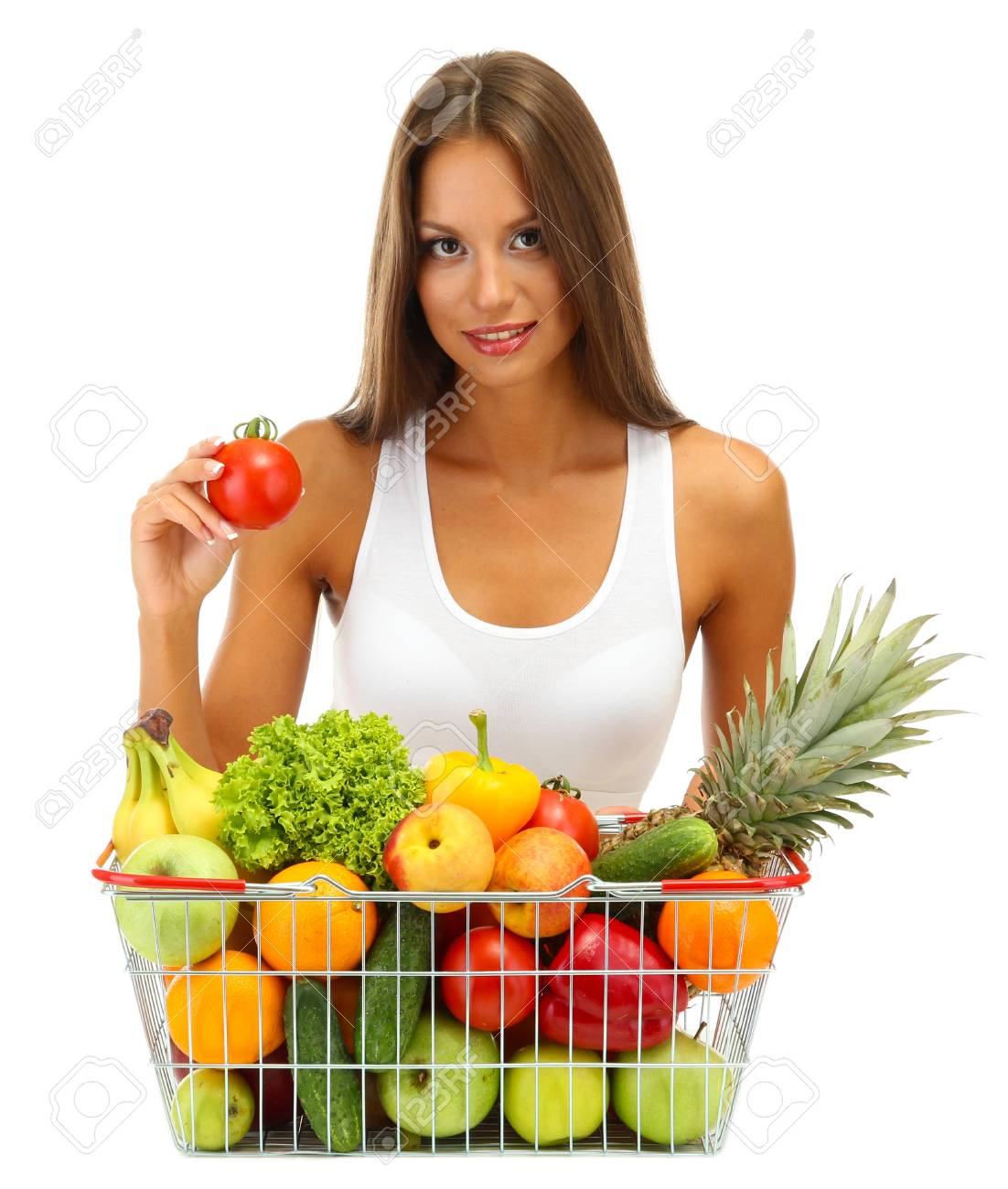 beautiful young woman with fruits and vegetables in shopping basket, isolated on white Stock Photo - 17281807