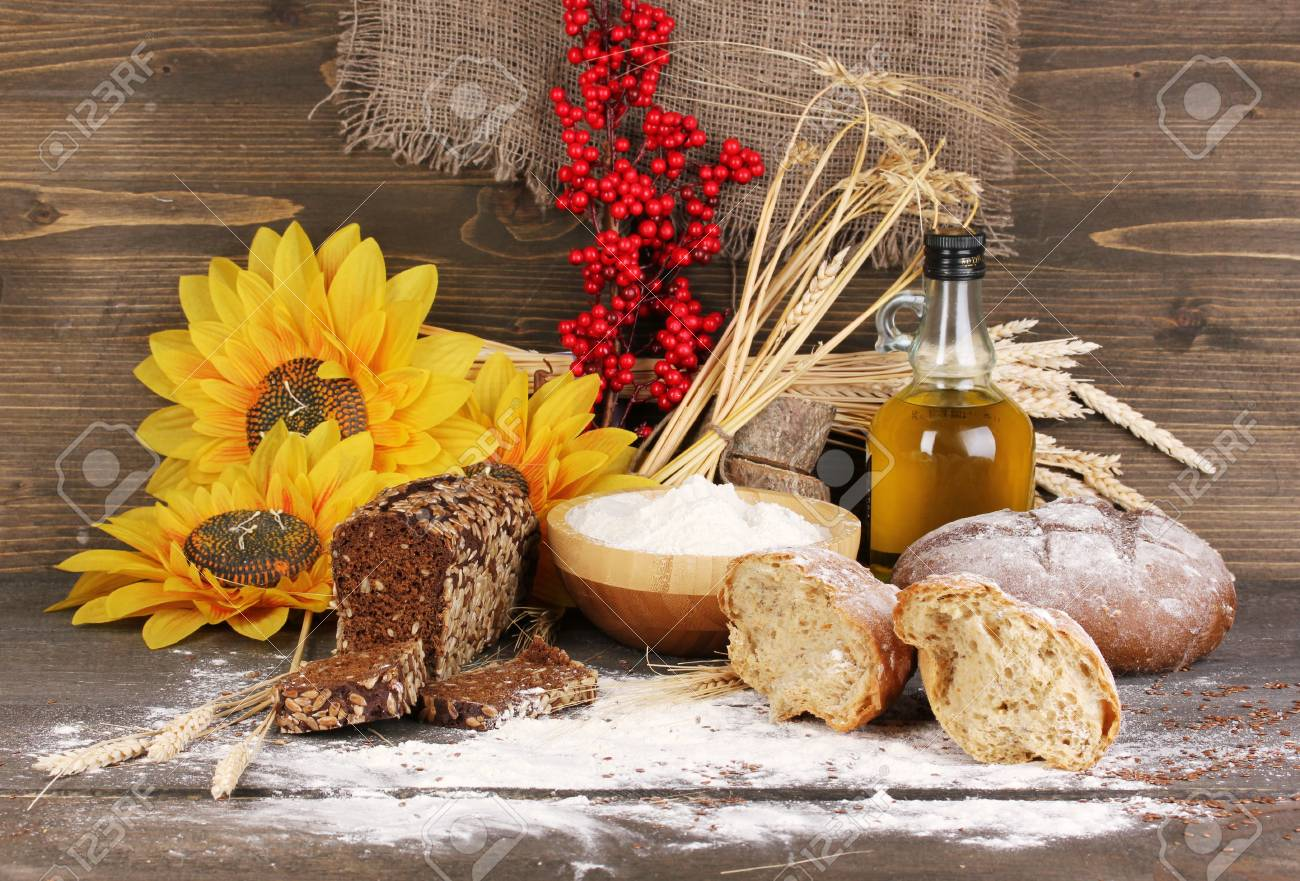 Rye bread on wooden table on wooden background Stock Photo - 16570573