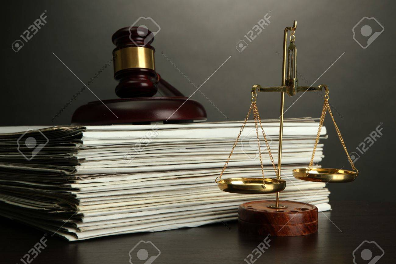 Golden scales of justice, gavel and books on grey background Stock Photo - 16604736
