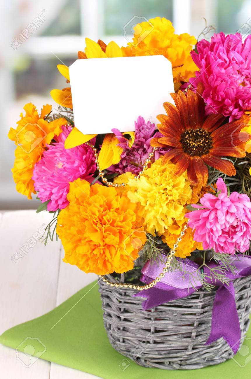 Beautiful Bouquet Of Bright Flowers With Paper Note On Wooden