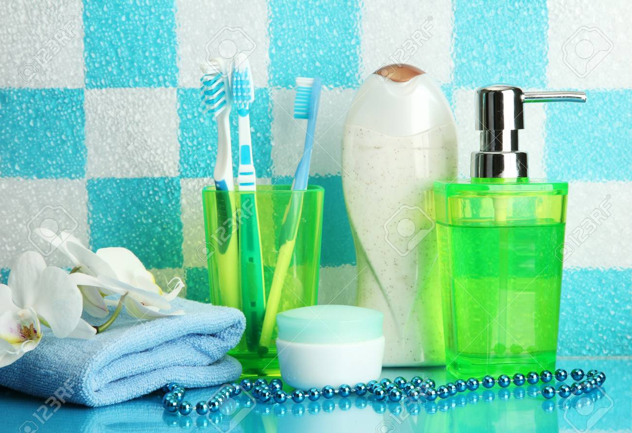 Bath accessories on shelf in bathroom on blue tile wall background Stock Photo - 16739926