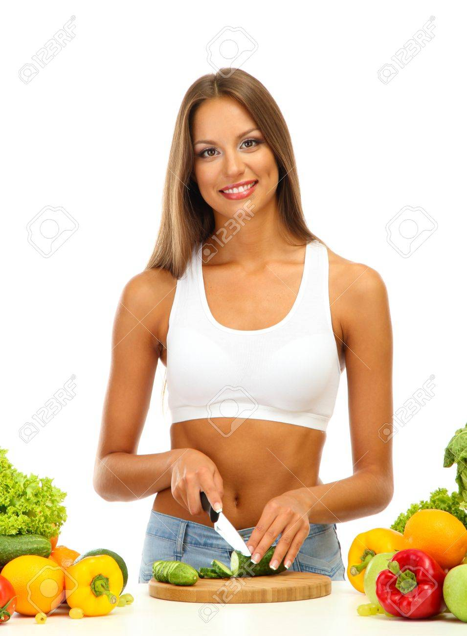 beautiful young woman cutting vegetables, isolated on white Stock Photo - 17281809