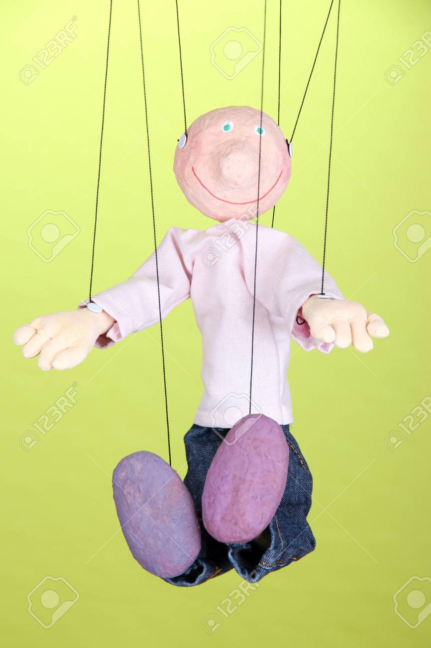 Wooden puppet on green background Stock Photo - 16765078