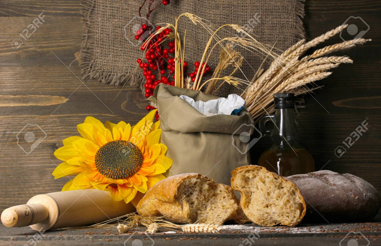 Rye bread on wooden table on wooden background Stock Photo - 16772640
