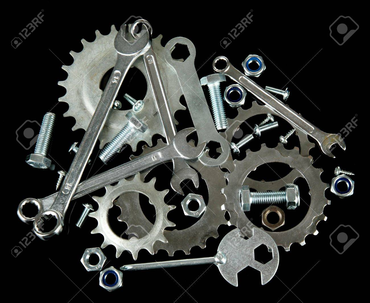 Machine gear, metal cogwheels, nuts and bolts isolated on black Stock Photo - 16772418