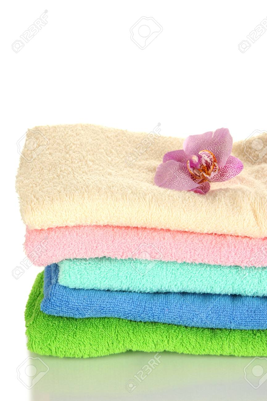 Stack of towels with fragrant flower isolated on white Stock Photo - 16859529