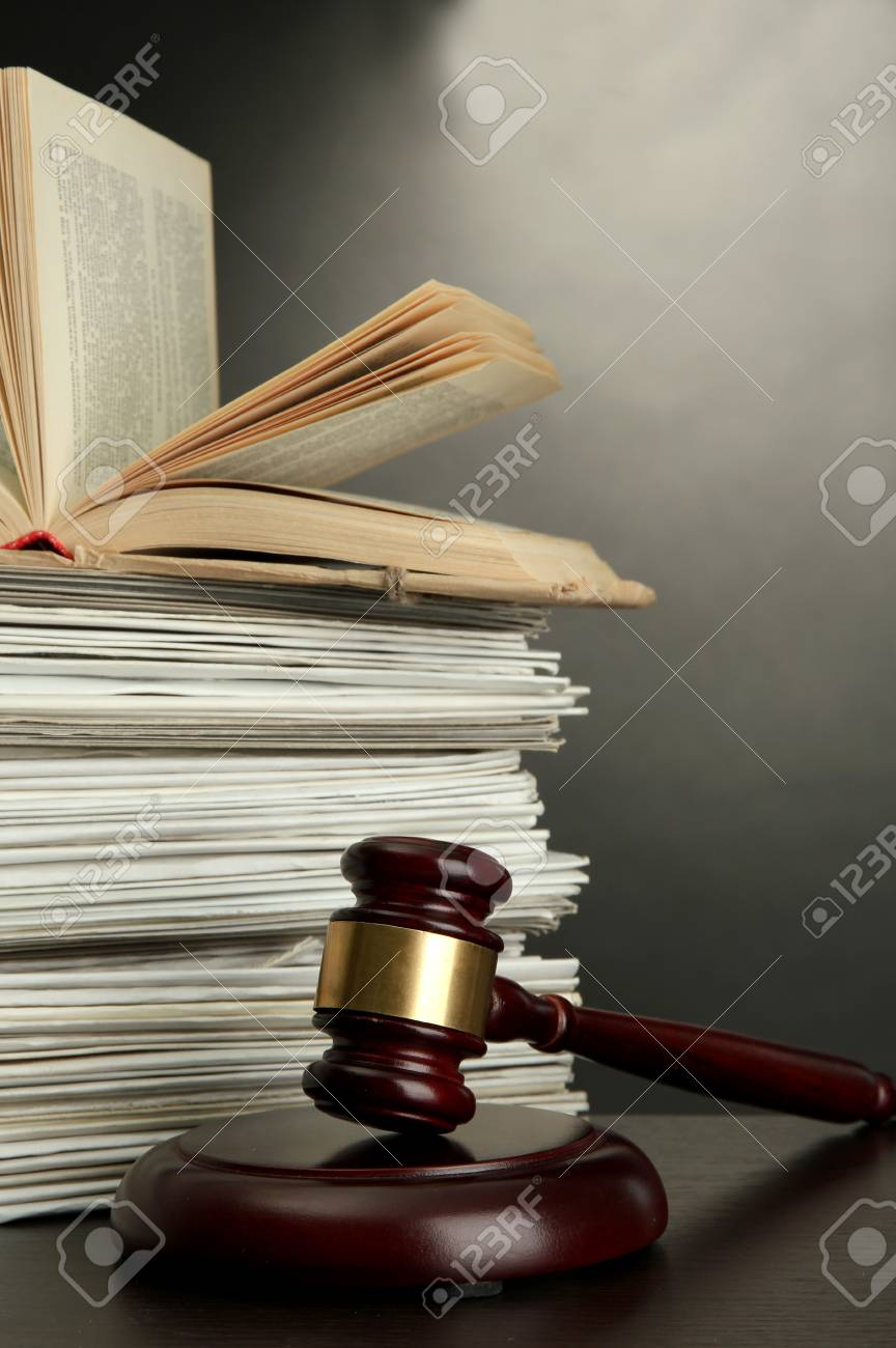 gavel and old papers on grey background Stock Photo - 16861024