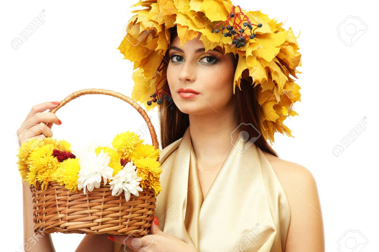 beautiful young woman with yellow autumn wreath and basket with flowers, isolated on white Stock Photo - 17051955