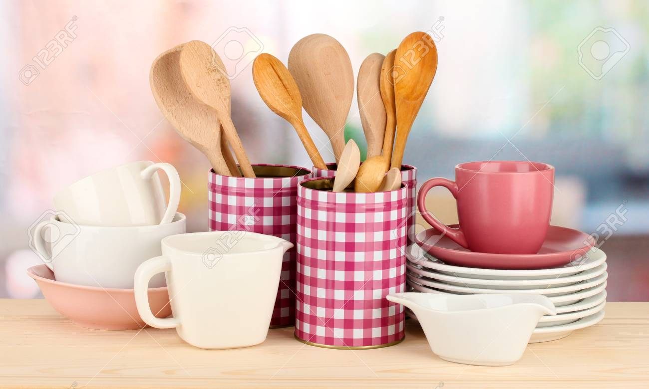 Cups, bowls nd other utensils in metal containers isolated on light background Stock Photo - 16911242