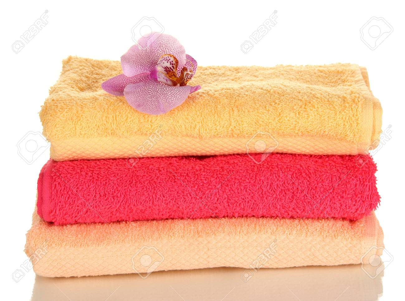 Stack of towels with fragrant flower isolated on white Stock Photo - 16911879