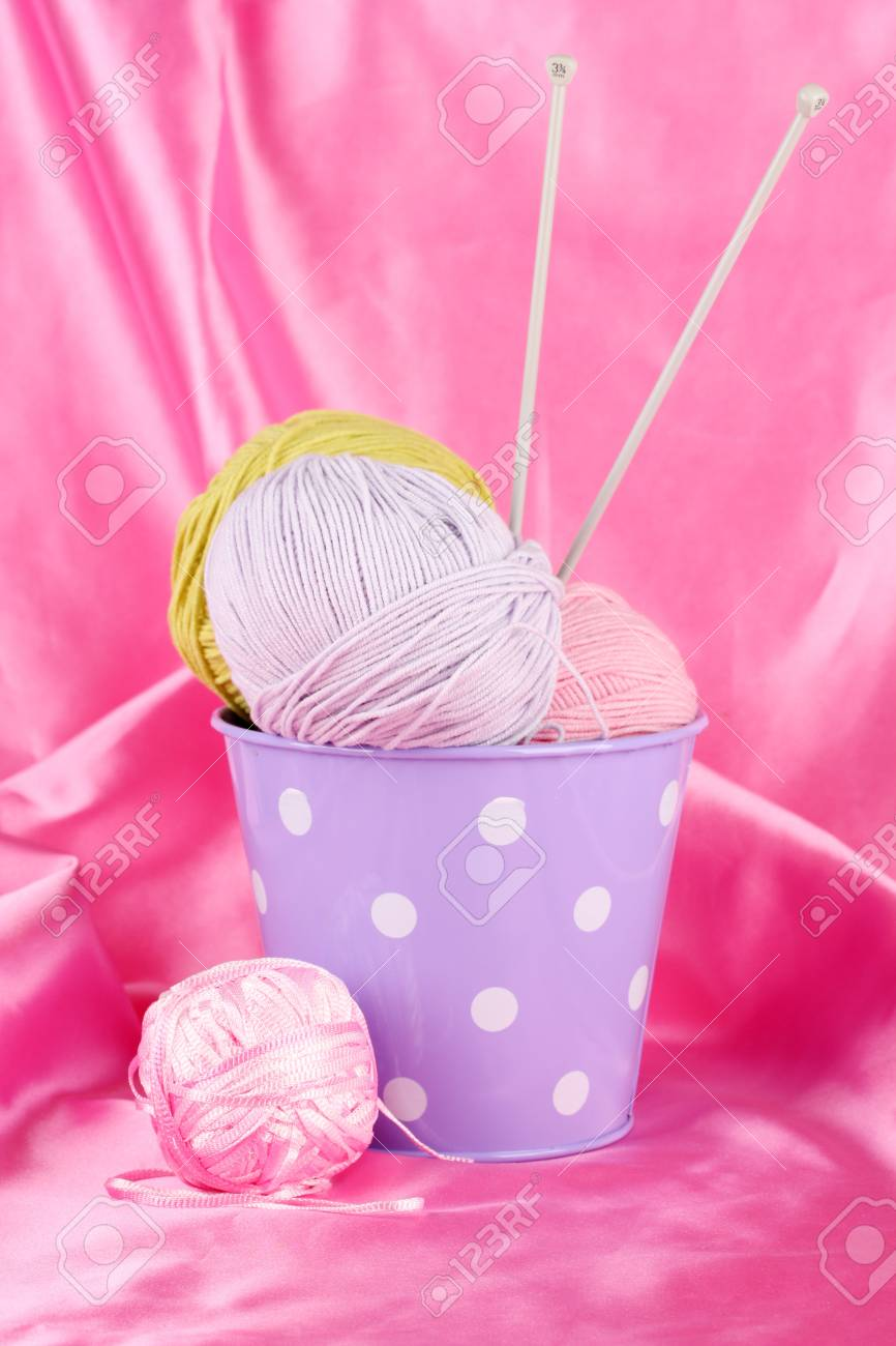 Color bucket with multicolor  balls of tread on color fabric background Stock Photo - 16939307