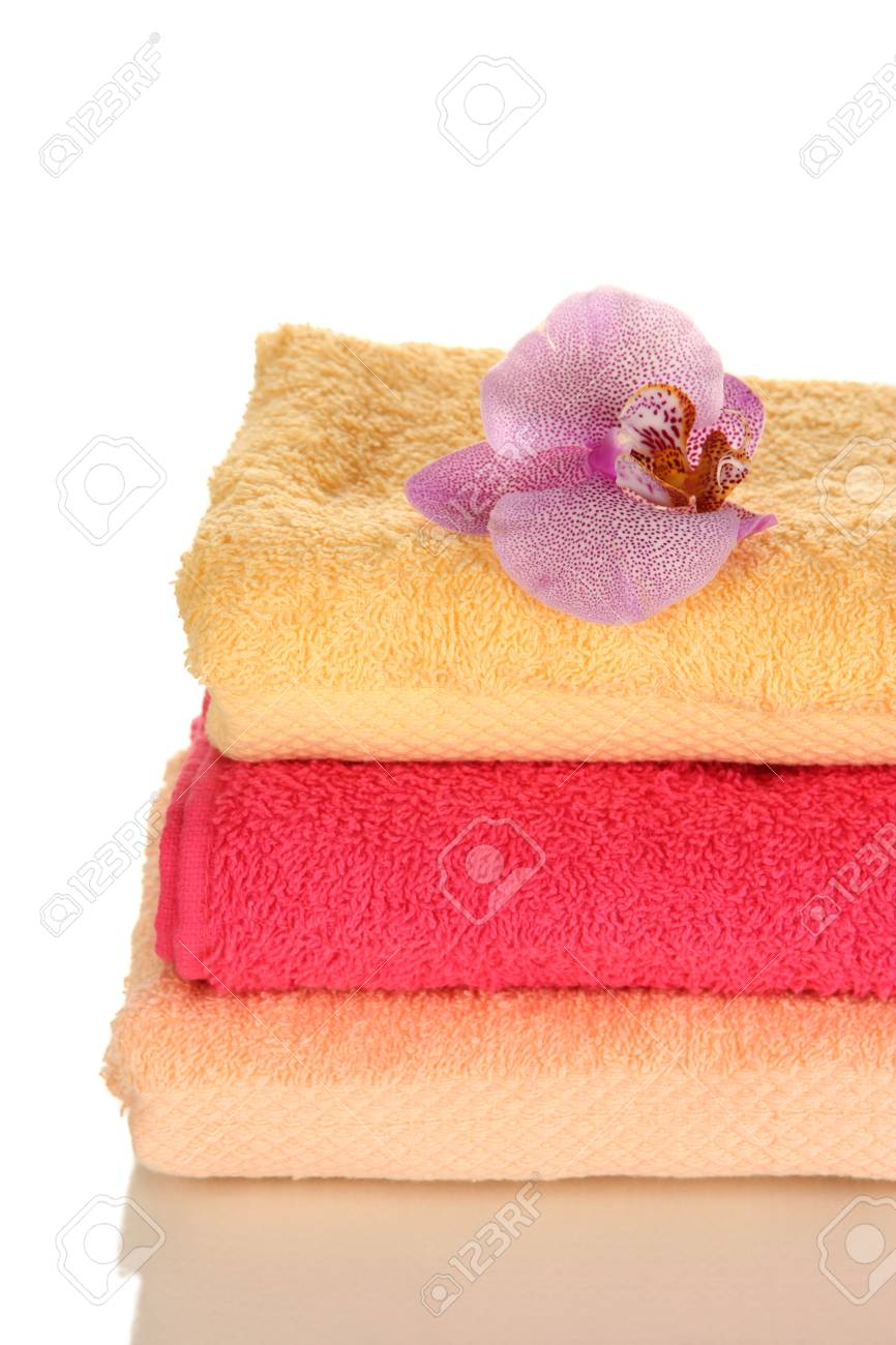 Stack of towels with fragrant flower isolated on white Stock Photo - 16939238