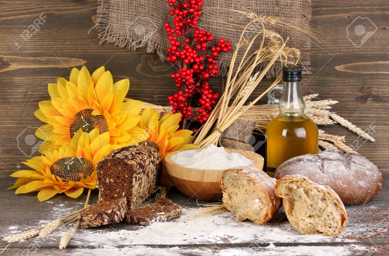 Rye bread on wooden table on wooden background Stock Photo - 16965630
