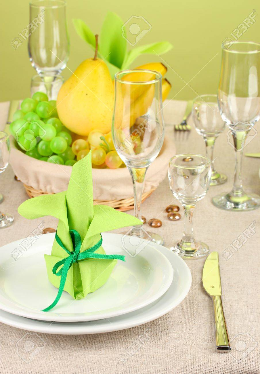 Table setting in green and yellow tones on color  background Stock Photo - 16997201