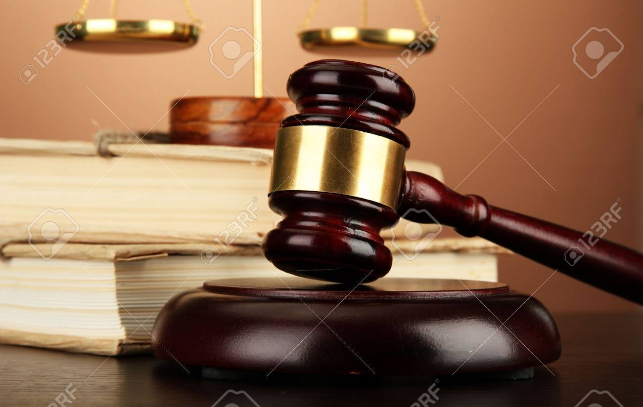 Golden scales of justice, gavel and books on brown background Stock Photo - 17001256