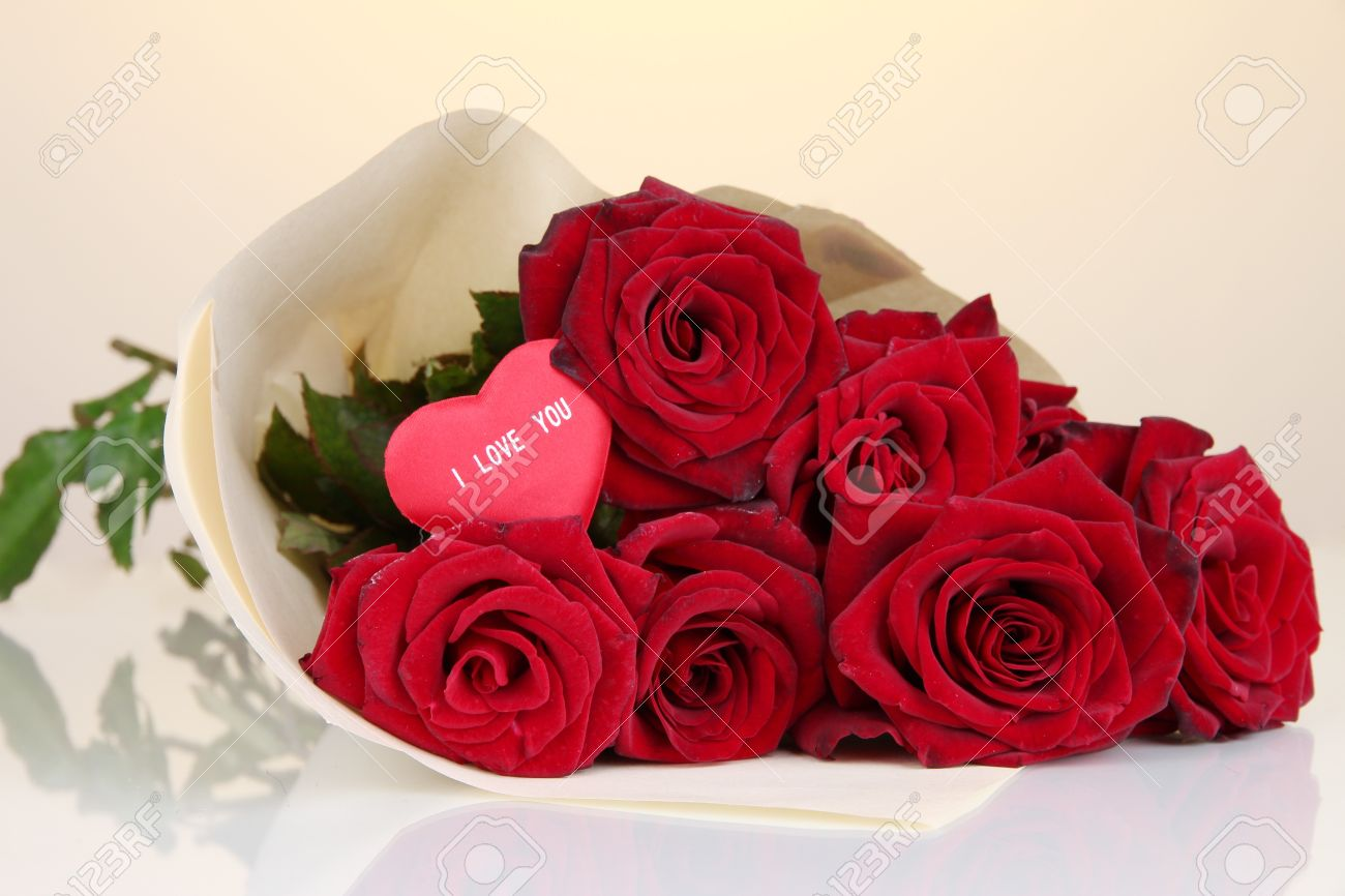 Beautiful bouquet of red roses with valentine on yellow background beautiful bouquet of red roses with valentine on yellow background stock photo 17036808 dhlflorist Image collections