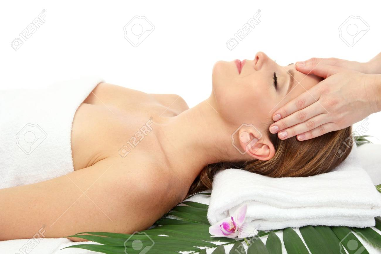 Portrait of beautiful woman in spa salon taking head massage Stock Photo - 17282485