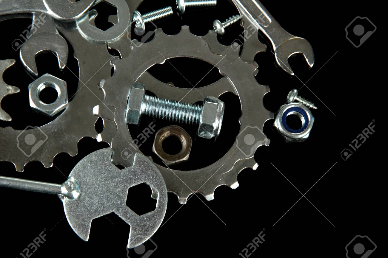 Machine gear, metal cogwheels, nuts and bolts isolated on black Stock Photo - 17052220