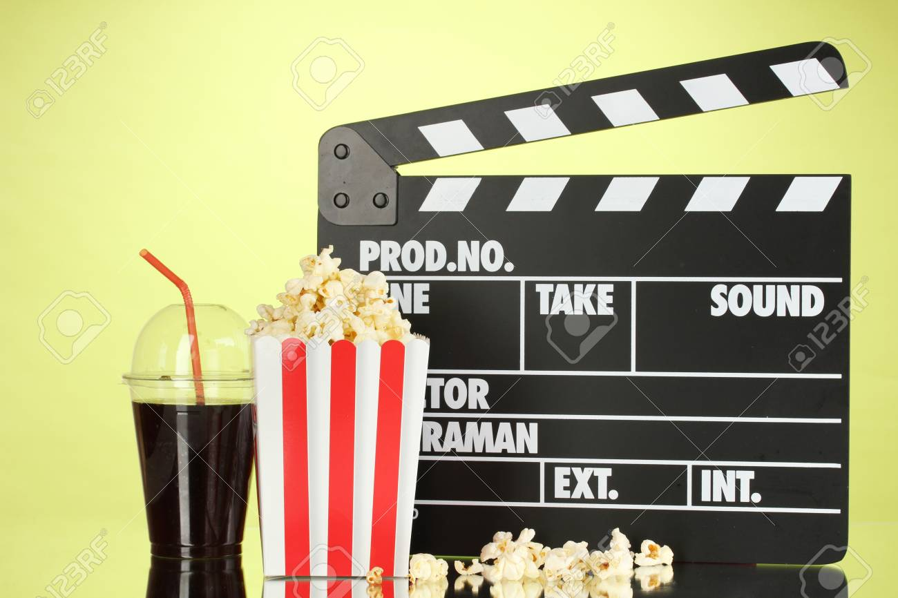 Movie clapperboard, cola and popcorn on background Stock Photo - 17052208