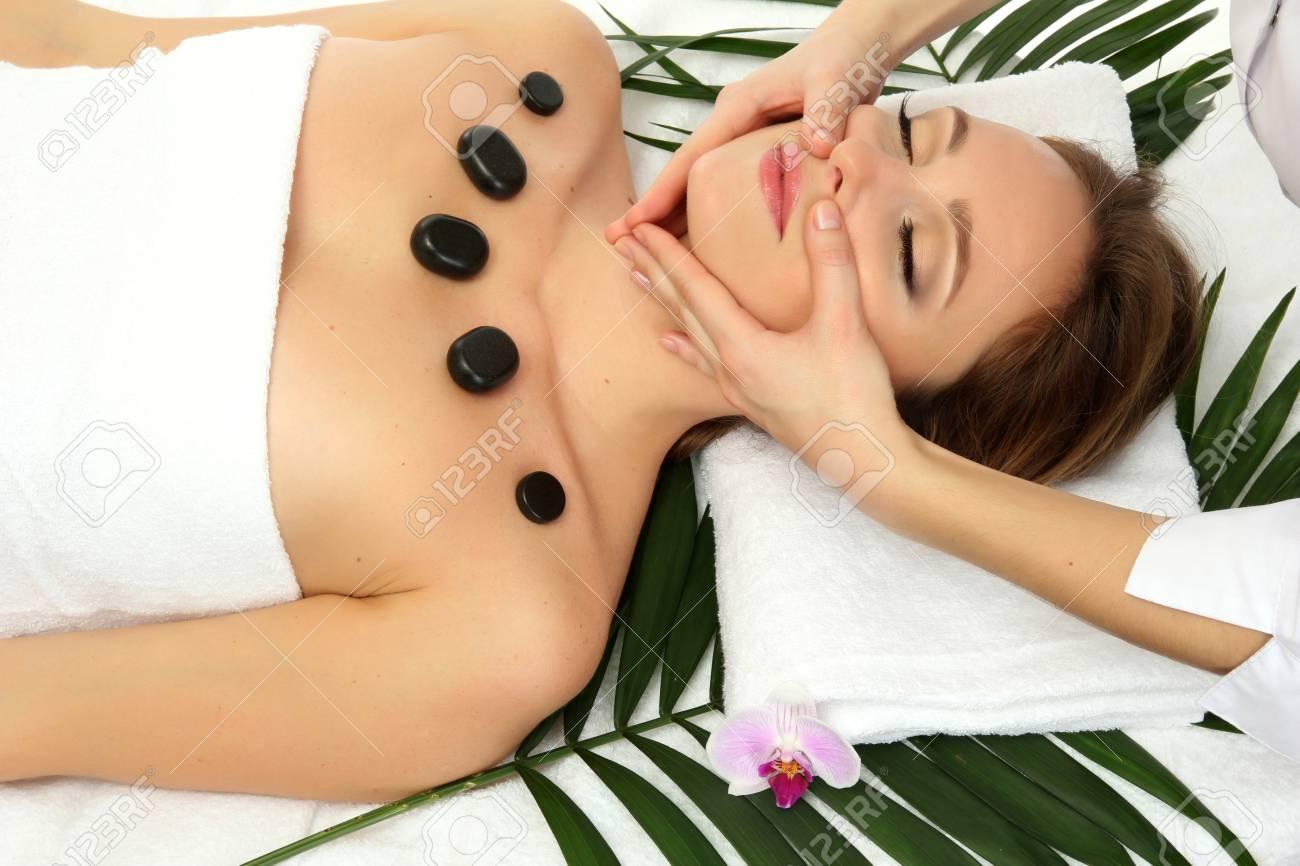 Portrait of beautiful woman with spa stones taking head massage Stock Photo - 17282481