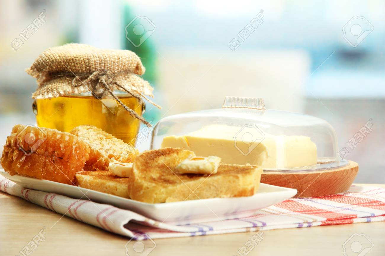 White bread toastwith honey on plate in cafe Stock Photo - 17053116