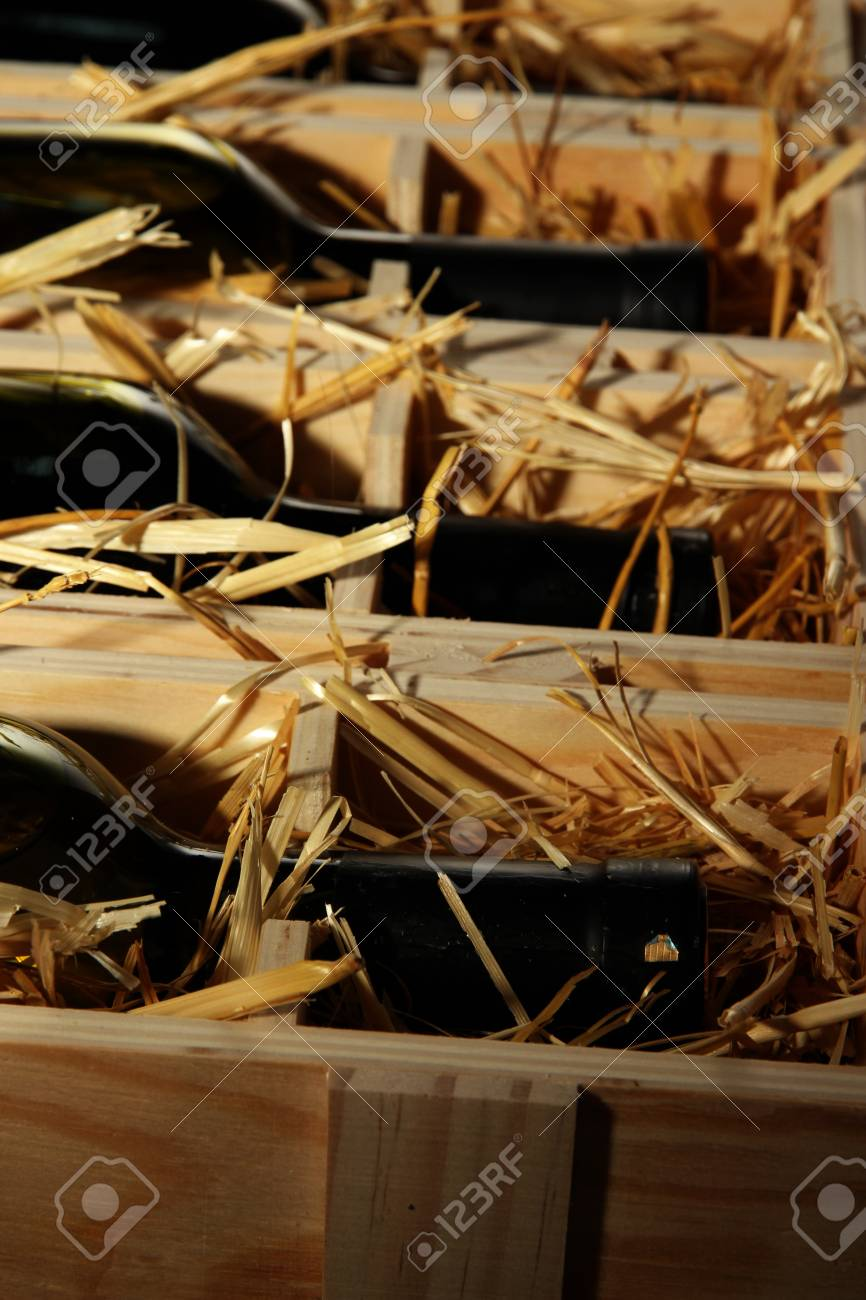 Wooden case with wine bottles close up Stock Photo - 17053170