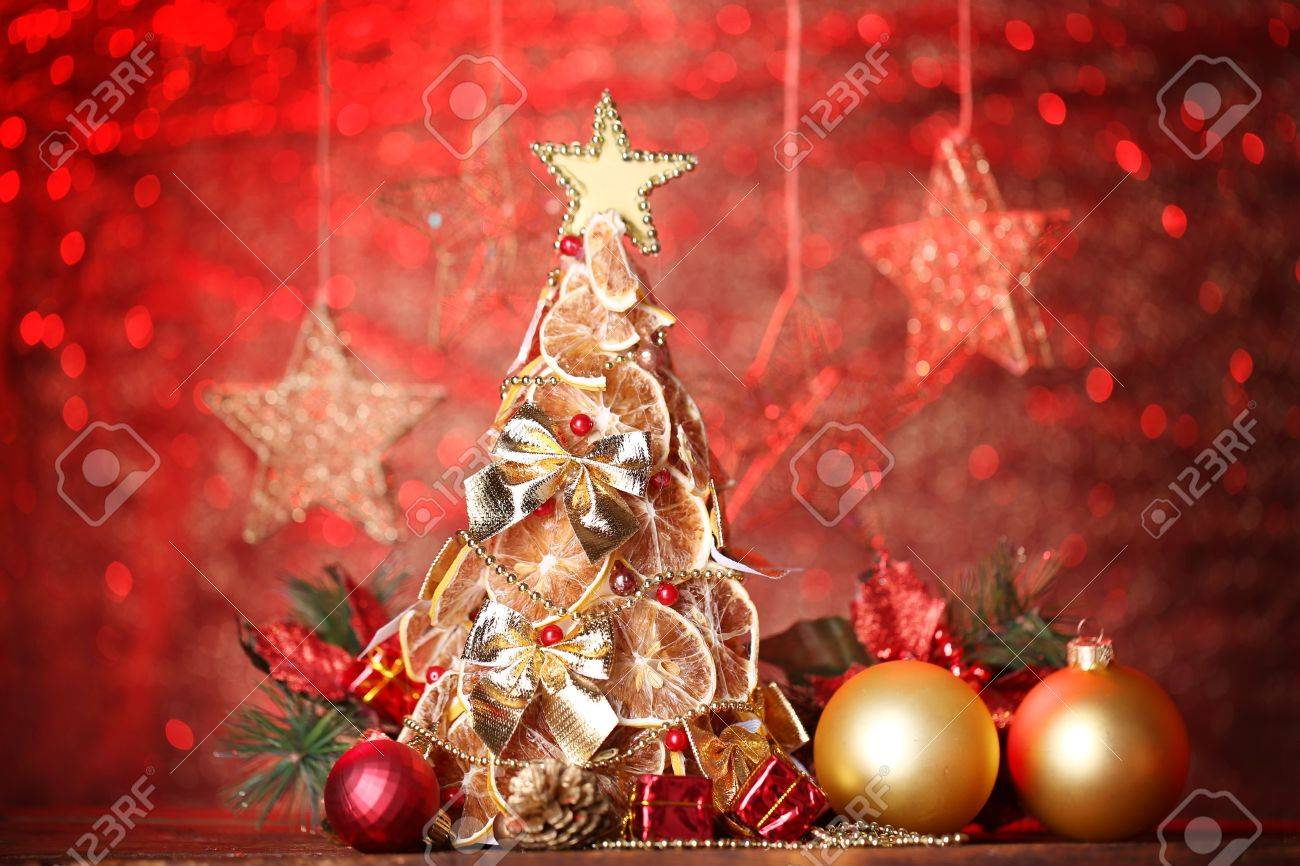 Beautiful Christmas Tree Of Dry Lemons With Decor On Red Background